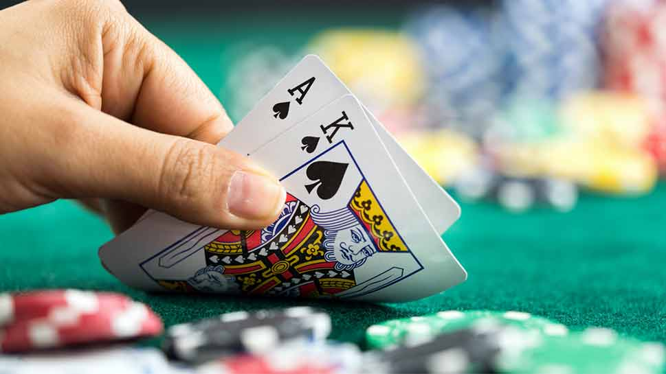 Blackjack game with man holding cards